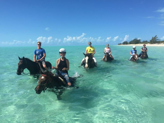 Horseback-riding-in-the-clear-ocean-waters